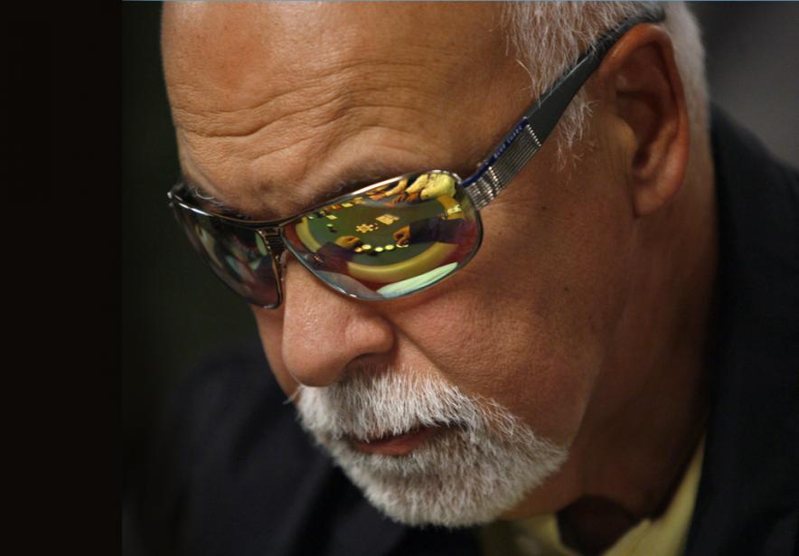 René Angélil lors d'un tournoi de poker en... (Photothèque La Presse Canadienne/Associated Press,Laura Rauch)