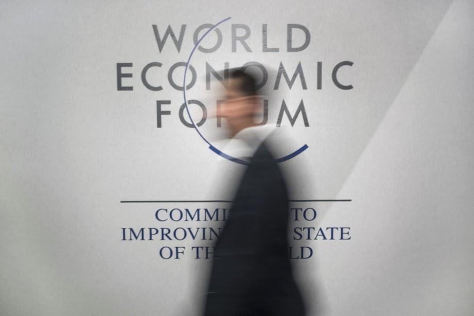 Le thème officiel de ce remue-méninges mondial est... (PHOTO FABRICE COFFRINI, AFP)