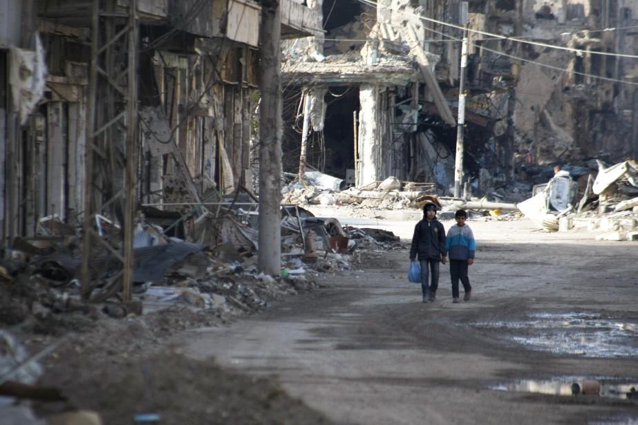 Selon l'ONU, environ 70% des habitants des quartiers... (PHOTO ARCHIVES AFP)