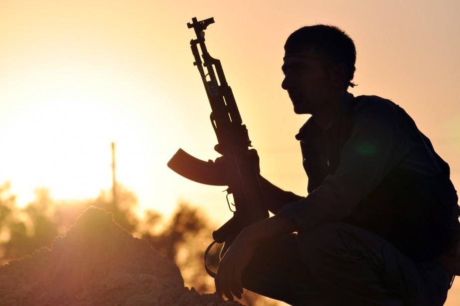 Ankara considère le PYD et les YPG comme... (PHOTO DELIL SOULEIMAN, ARCHIVES AFP)