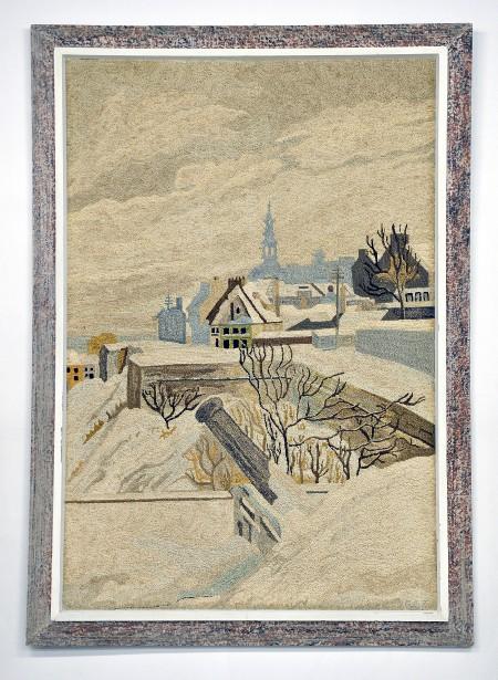 Tapis crocheté encadré fabriqué par Georges-Édouard Tremblay de Charlevoix vers 1920. Il s'agit d'une scène de Québec en hiver présentant les remparts. (Le Soleil, Patrice Laroche)