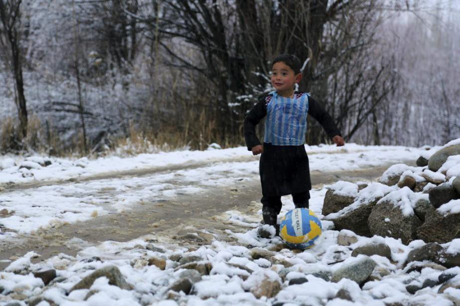 La bouille réjouie de Murtaza Ahmadi, le haut... (PHOTO AGENCE FRANCE-PRESSE)