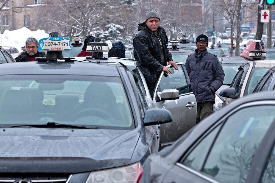 «À Montréal, le nombre de permis de taxi... (PHOTO PATRICK SANFAÇON, ARCHIVES LA PRESSE)