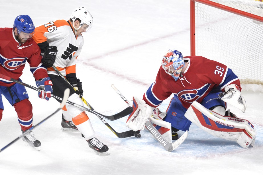 Mike Condon bloque un tir de Chris VandeVelde. (PHOTO BERNARD BRAULT, LA PRESSE)