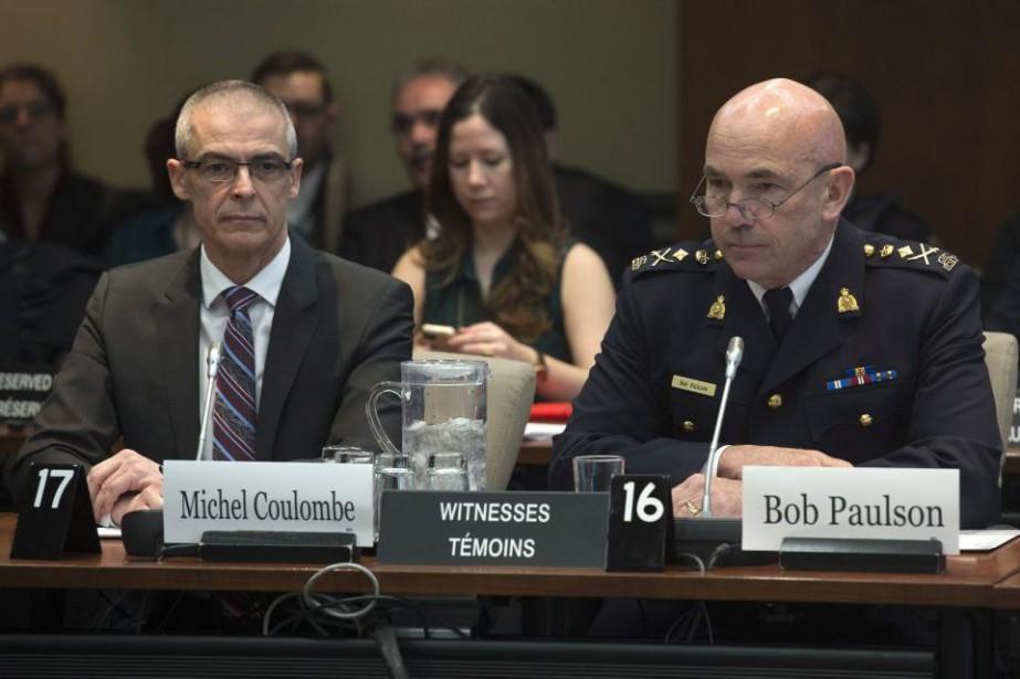 Le directeur du SCRS Michel Coulombe et lecommissaire... (PHOTO ADRIAN WYLD, ARCHIVES LA PRESSE CANADIENNE)