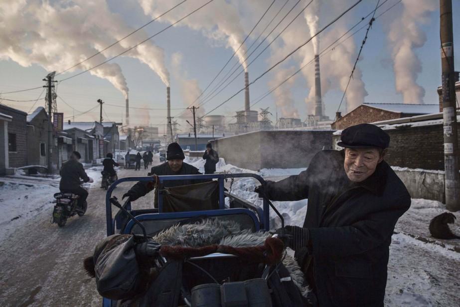 En mars 2015, la concentration mondiale moyenne mensuelle... (PHOTO KEVIN FRAYER, WORLD PRESS PHOTO/AP)