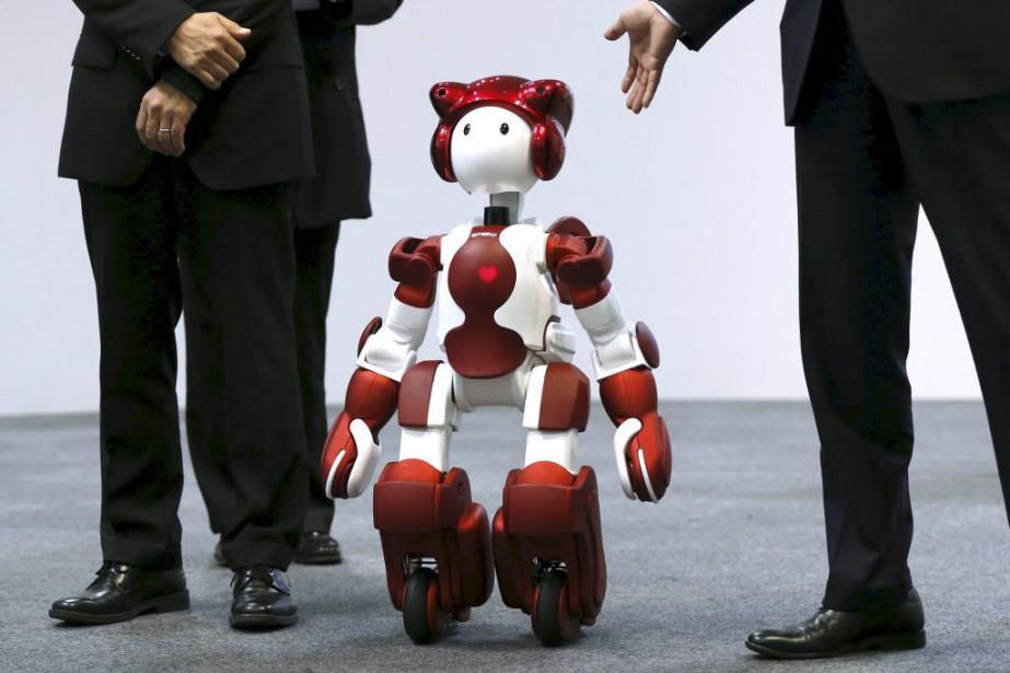 Hitachi a dévoilé son nouveau robot Emiew3vendredi, à... (PHOTO ISSEI KATO, REUTERS)