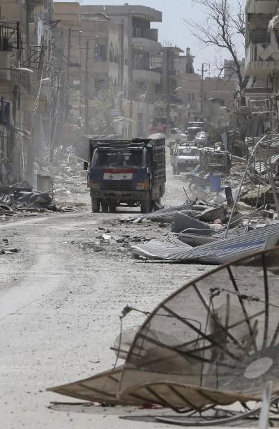 LLa ville d'al-Qaryatain, près de Palmyre, a été dévastée. Les habitants de la cité antique doivent rentrer chez eux à compter de samedi. (AFP, Joseph Eid)