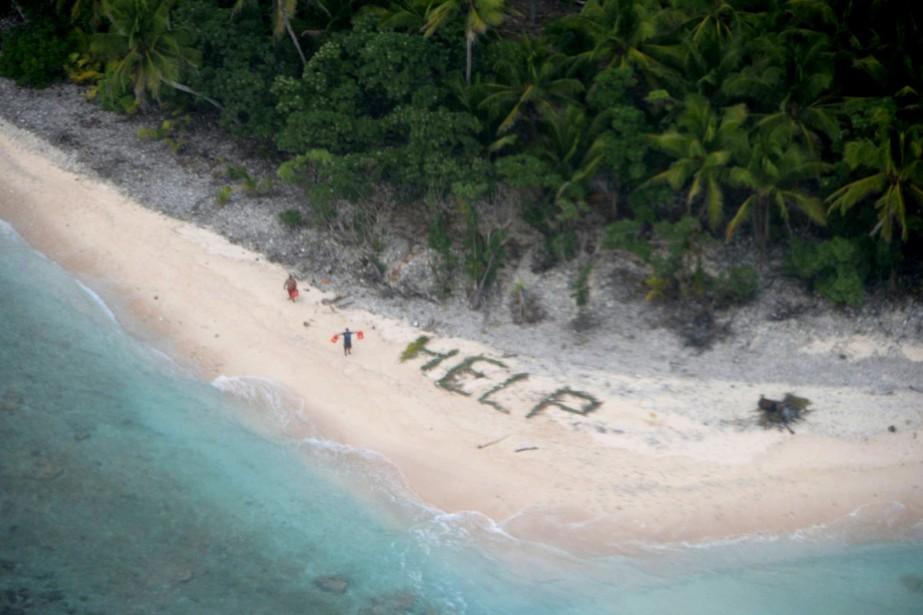 Les hommes avaient écrit un message visible du... (Photo REUTERS)