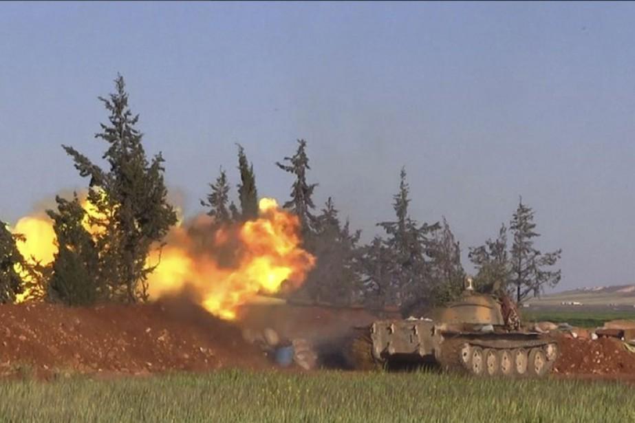 Au moins 19 membres du Front Al-Nosra, branche... (Al-Nusra Front via AP)