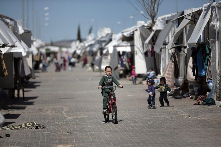 Parmi les 4,8millions de réfugiés syriens officiellement enregistrés,... (PHOTO LEFTERIS PITARAKIS, ARCHIVES ASSOCIATED PRESS)
