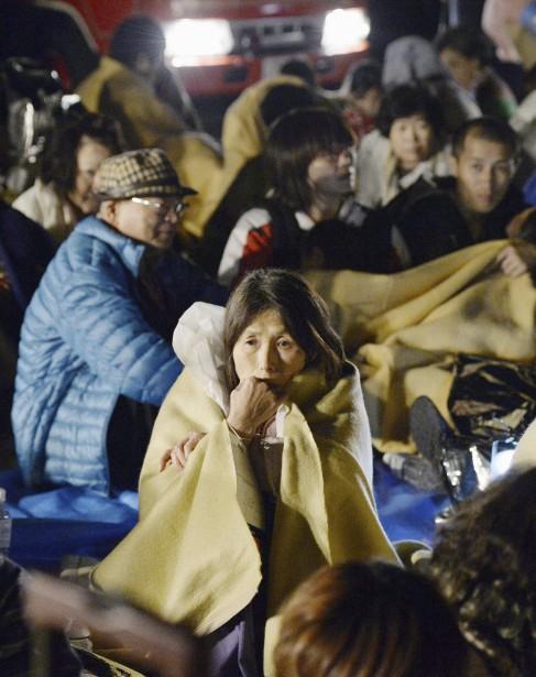 Quelque 18 000 personnes se sont réfugiées dans les centres ouverts dans des bâtiments publics du Japon. (Ryosuke Uematsu, Kyodo News via AP)