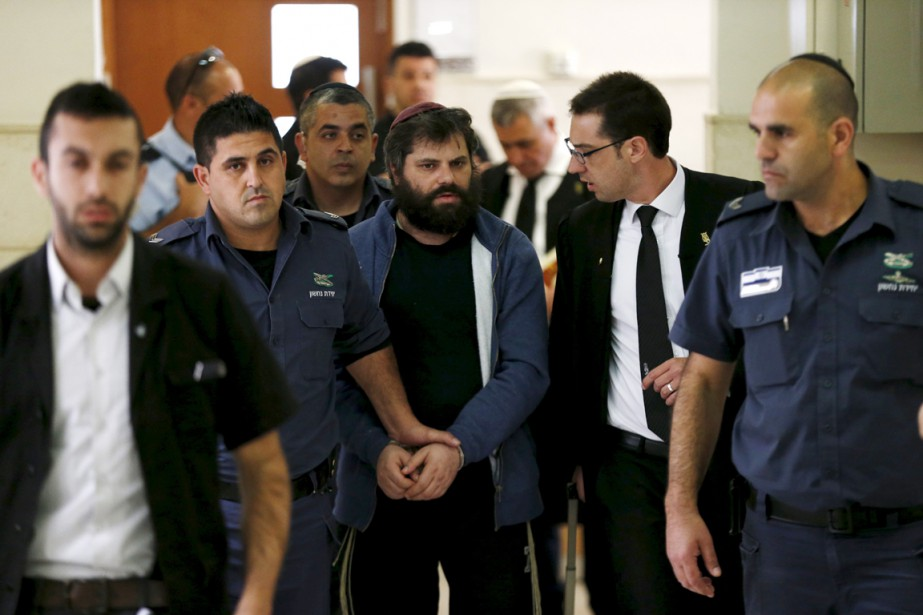 Yosef Haim Ben David (au centre), 31 ans,... (PHOTO AMMAR AWAD, REUTERS)