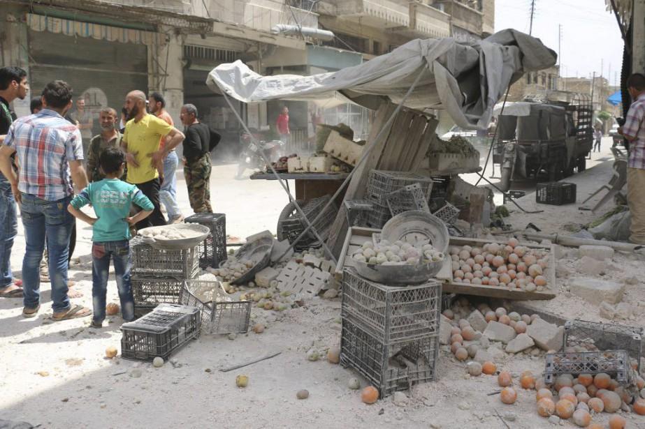 Au moins 26 civils ont été tués dimanche... (PHOTO AMEER ALHALBI, AGENCE FRANCE-PRESSE)
