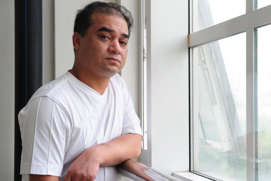 Ilham Tohti, 47 ans, est un universitaire «modéré»... (PHOTO FREDERIC J. BROWN, ARCHIVES AFP)