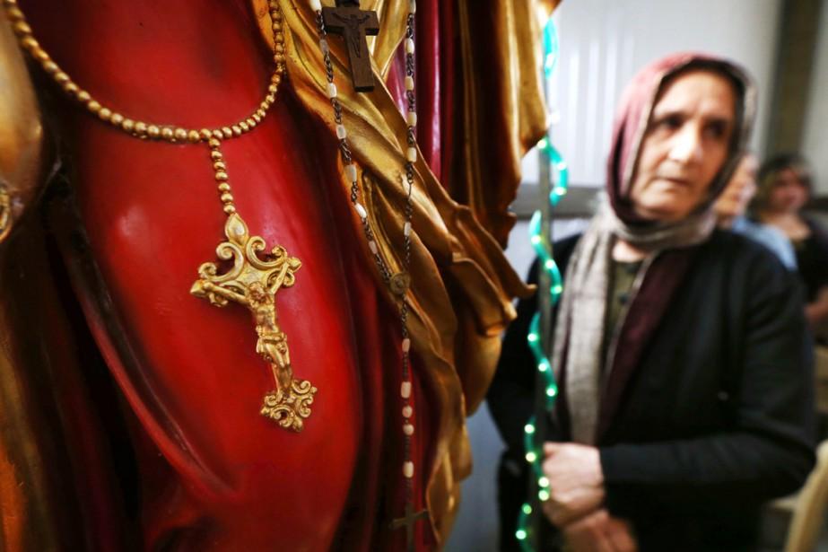 Plus de 2 millions en 1977, les chrétiens... (PHOTO SAFIN HAMED, ARCHIVES AFP)