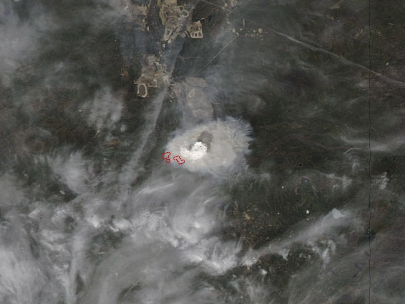 Photo satellitaire de la région de Fort McMurray prise par la NASA (La Presse Canadienne, HO-NASA)