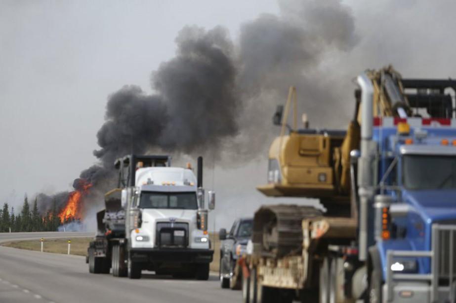 Sur les derniers jours, l'avancée infernale des flammes... (PHOTO COLE BURSTON, AFP)