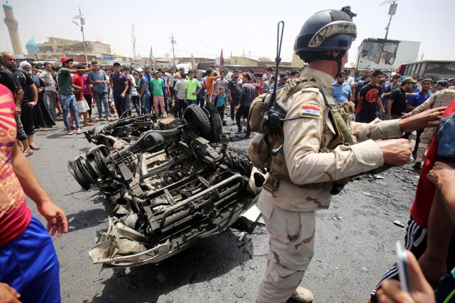 Le kamikaze afait exploser sa voiture piégée dans... (PHOTO AHMAD AL-RUBAYE, AFP)