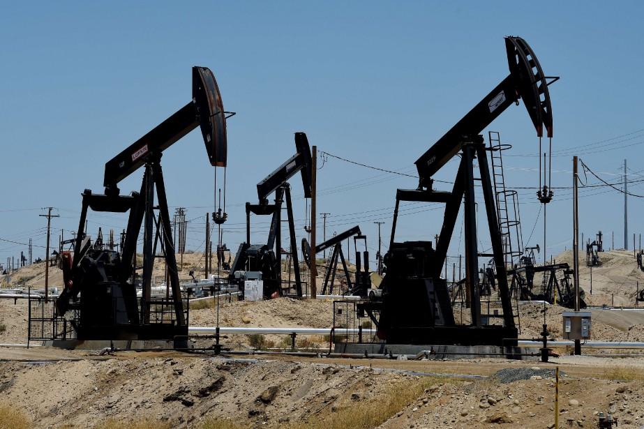 Les cours du pétrole progressaient... (PHOTO MARK RALSTON, ARCHIVES AFP)