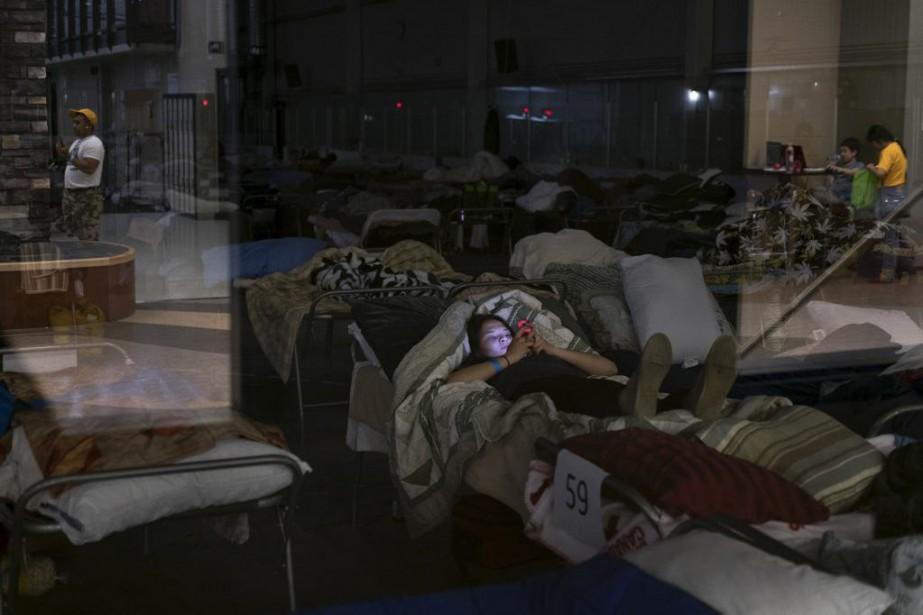 Des évacués dans un centre d'accueil à Lac... (PHOTO TYLER HICKS, THE NEW YORK TIMES)