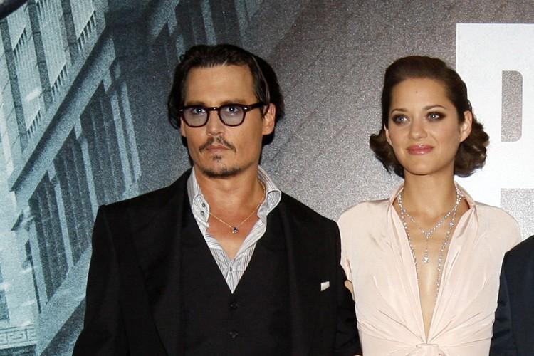 Johnny Depp et Marion Cotillard lors de la... (ARCHIVES REUTERS)