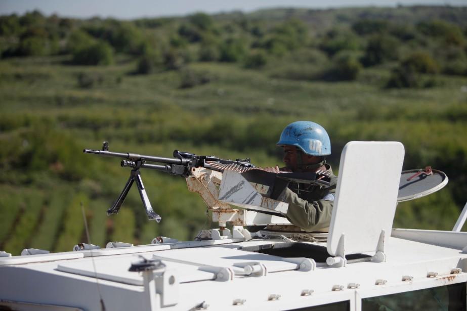 Les Casques bleus de 29 pays participant à... (PHOTO JALAA MAREY, AFP)