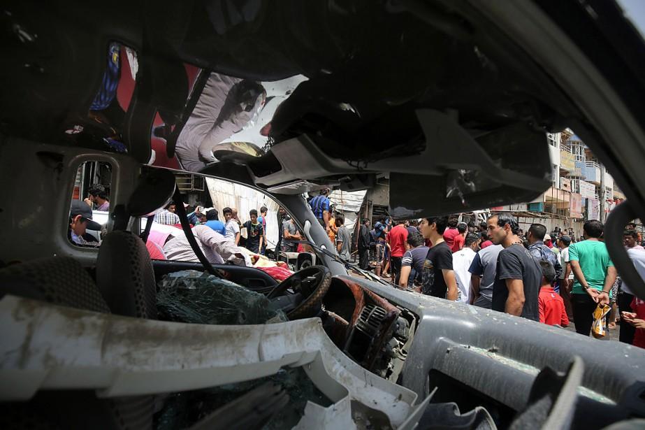 Le 11mai, au moins 94personnes avaient été tuées... (PHOTO AHMAD AL-RUBAYE, ARCHIVES AFP)