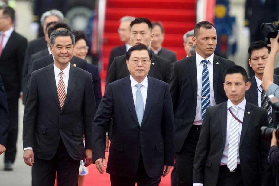 Zhang Dejiang (au centre), président de l'Assemblée nationale... (PHOTO / ISAAC LAWRENCE, AFP)