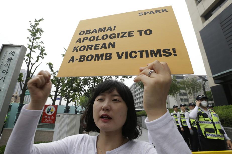 «Présentez vos excuses aux victimes coréennes de la... (Photo Ahn Young-joon, AP)