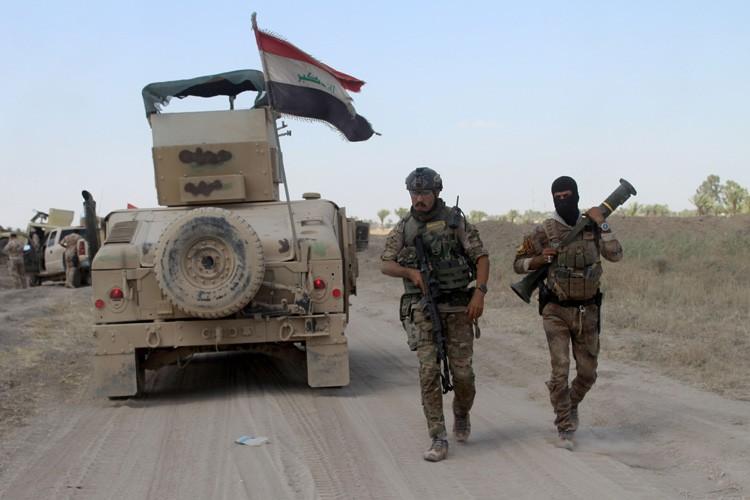 La bataille s'annonce longue et difficile, l'EI étant... (PHOTO AFP)