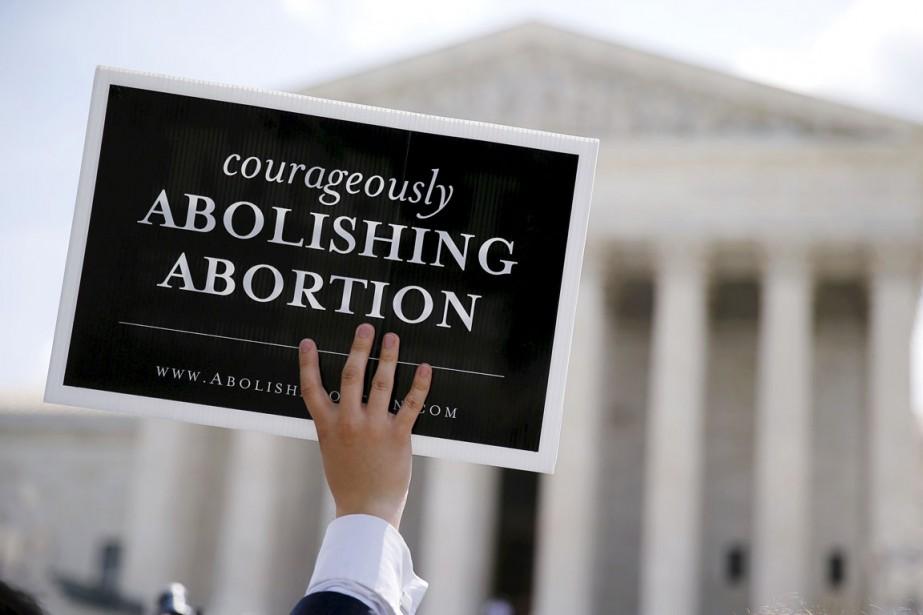 La plus haute instance judiciaire du pays va... (PHOTO Jim Bourg, ARCHIVES REUTERS)