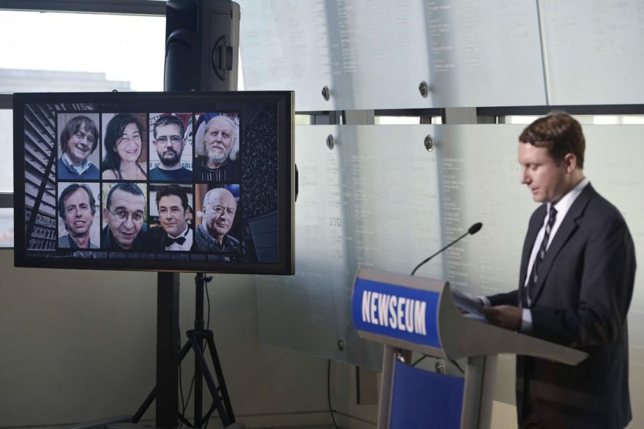 Les photos des journalistes de Charlie Hebdo (de... (PHOTO  MANDEL NGAN, AFP)