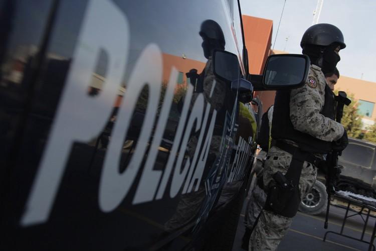 Les forces de sécurité mexicaines et un gang criminel... (ARCHIVES REUTERS)