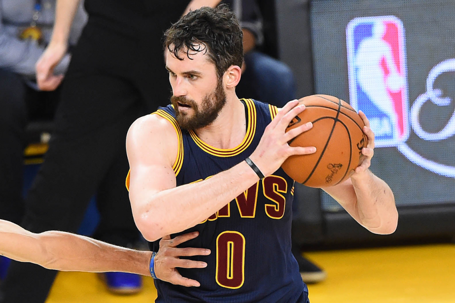 Kevin Love forme avec LeBron James et Kyrie Irving... (Photo Bob Donnan, USA Today)
