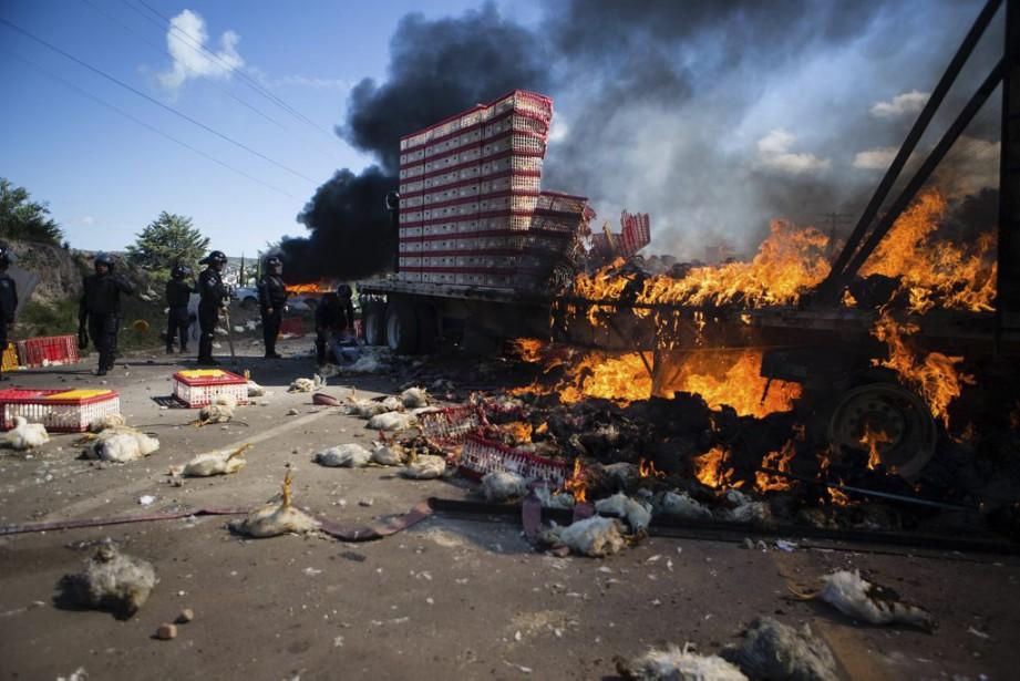 Lors des affrontements de dimanche, un journaliste de... (PHOTO AFP)
