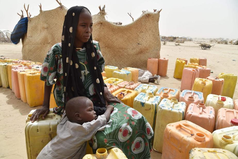 Plus de 50 000 personnes, qui ont fui... (PHOTO ISSOUF SANOGO, AFP)