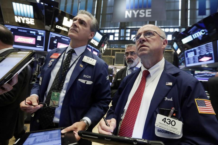 Comme l'ensemble des marchés mondiaux, Wall Street a... (Photo Richard Drew, AP)