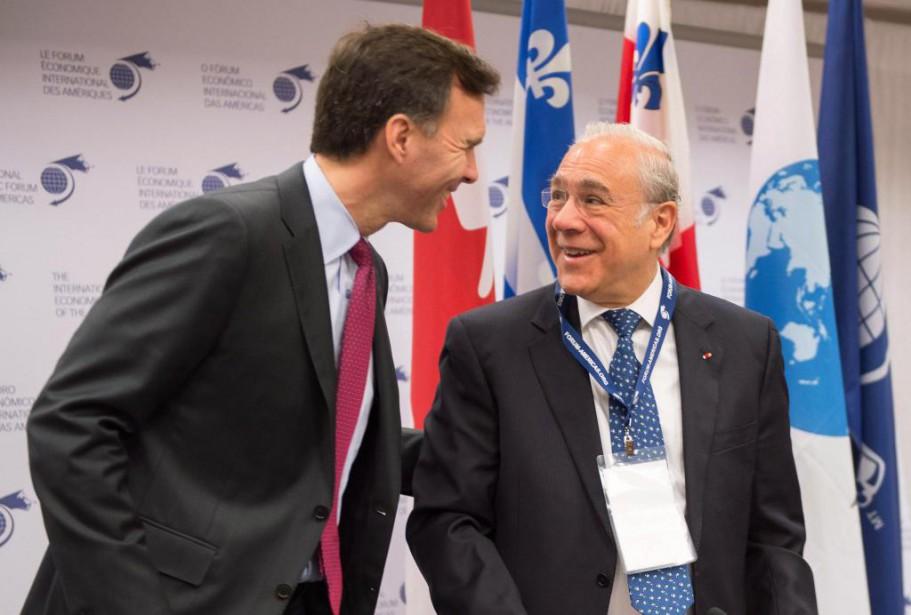 Le secrétaire général de l'OCDE, Angel Gurria (à... (PHOTO PAUL CHIASSON, LA PRESSE CANADIENNE)