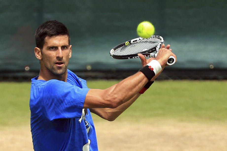 Novak Djokovic... (PHOTO ADAM DAVY, AP/PA)