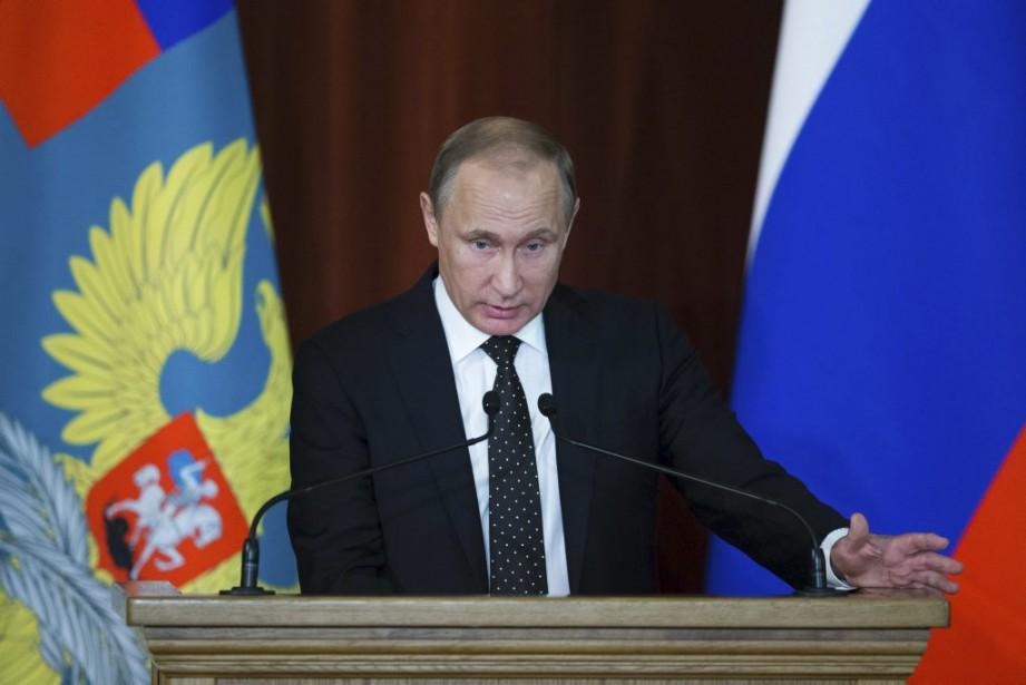 Le président russe Vladimir Poutine... (PHOTO IVAN SEKRETAREV, AFP)