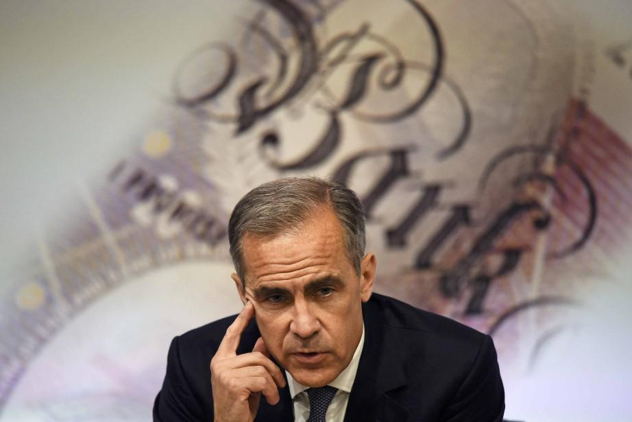 Le gouverneur de la Banque d'Angleterre, Mark Carney,... (Photo AFP)