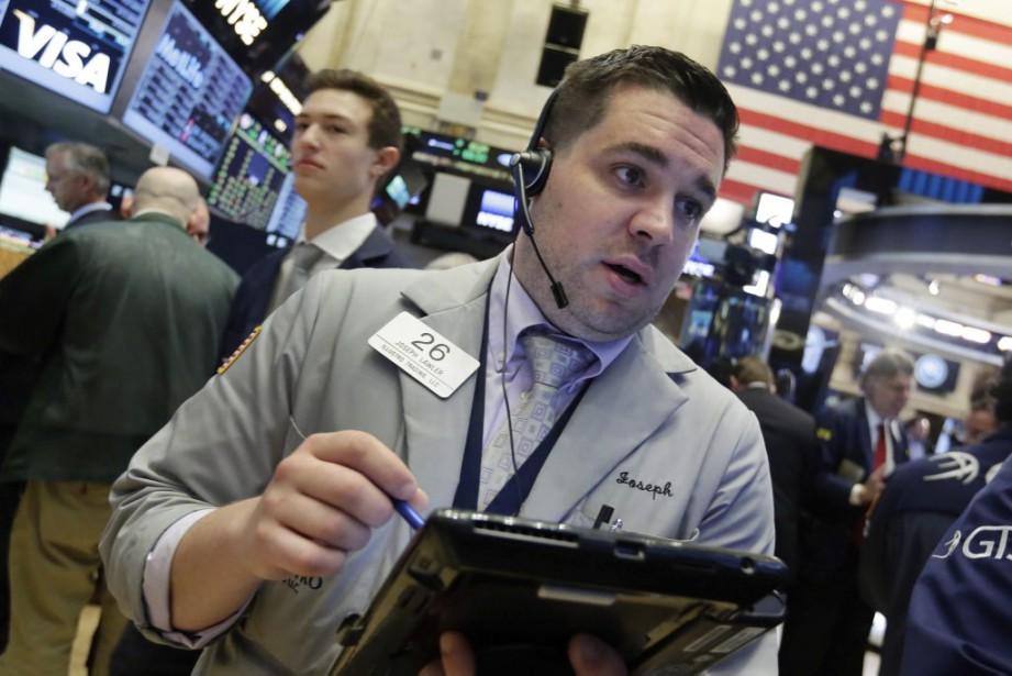Désormais, Wall Street poursuit sa descente alors que... (Photo Richard Drew, AP)