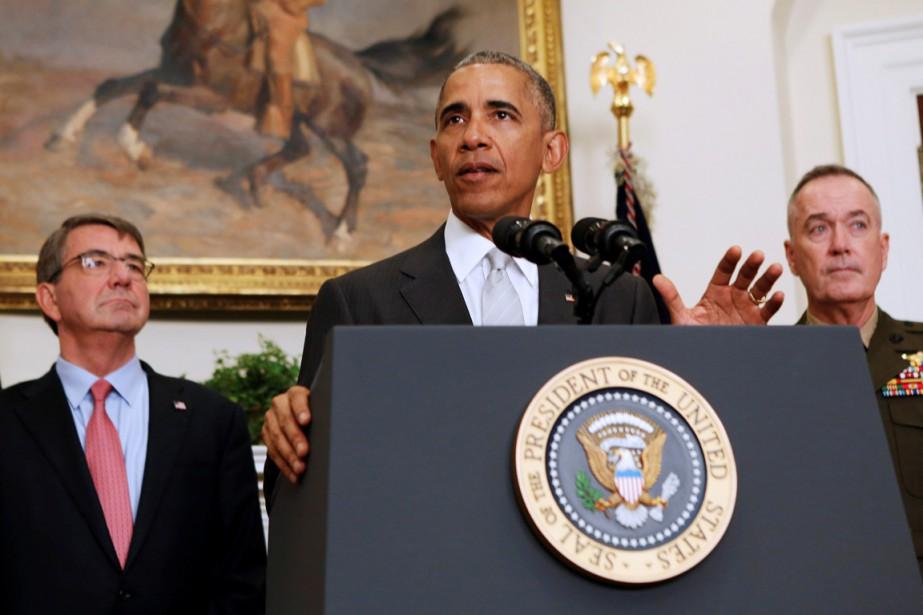 Le président Obama (au centre) à la Maison-Blanche... (PHOTO Gary Cameron, REUTERS)