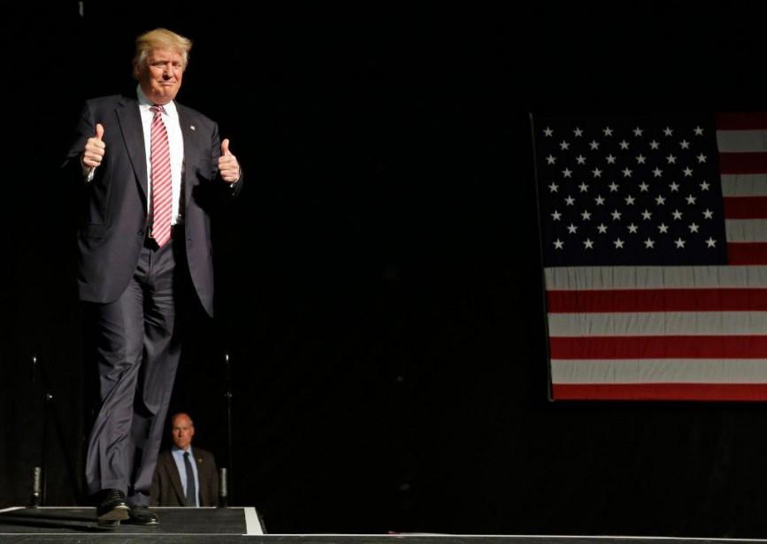 Pour plaire aux républicains et plus généralement aux... (PhotoChuck Burton, Archives Associated Press)