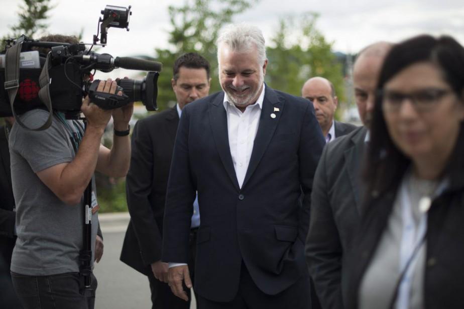 Le premier ministre du Québec Philippe Couillard arrive... (Photo JONATHAN HAYWARD, PC)