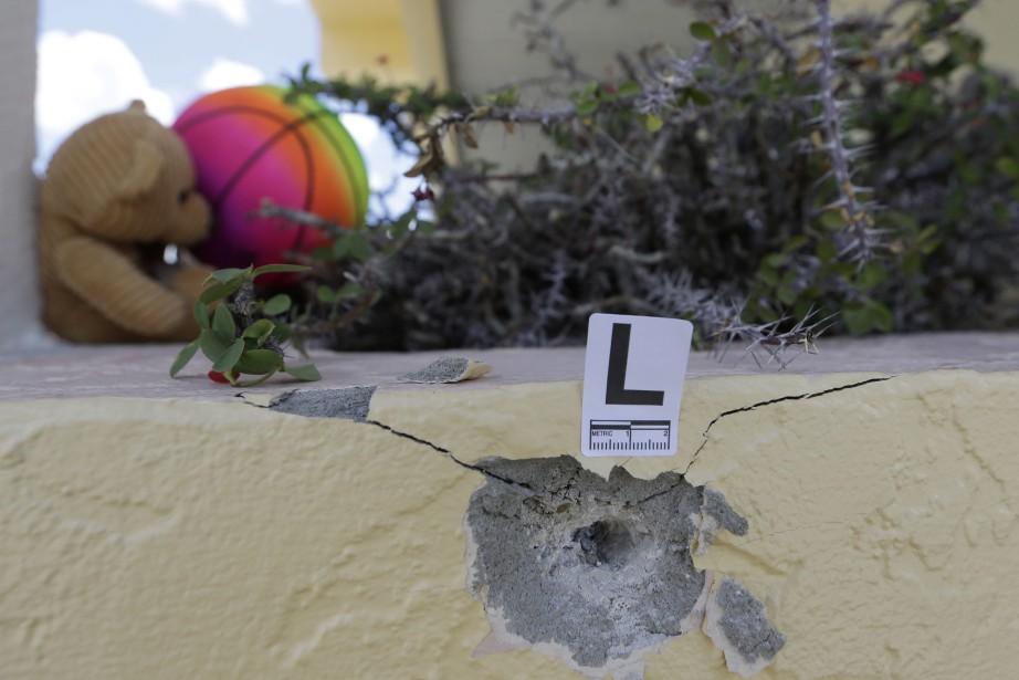 Un impact de balle marqué la police locale... (AP)