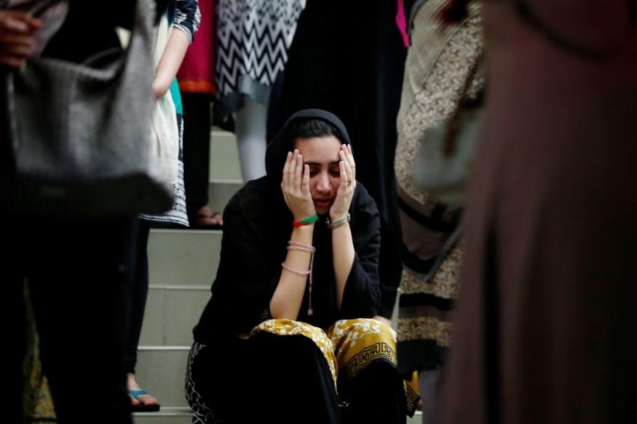 Une proche d'une des victimes de la tuerie... (PHOTO Adnan Abidi, archives REUTERS)