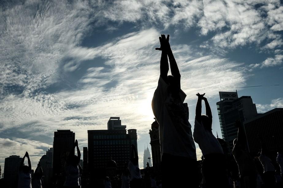 «Le yoga se résume à bien plus qu'à... (Photo Agence France-Presse)