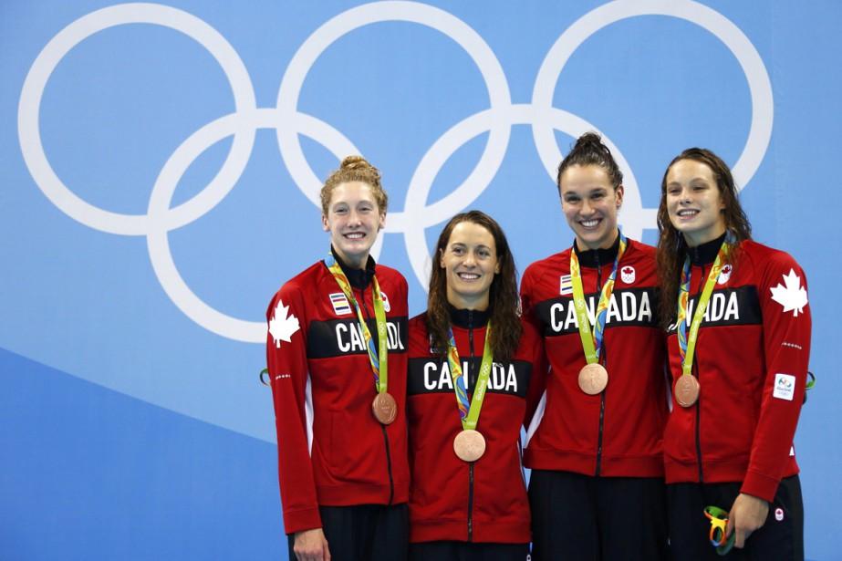 L'équipe canadienne, composée deTaylor Madison Ruck,Sandrine Mainville, Chantal... (PHOTO REUTERS)